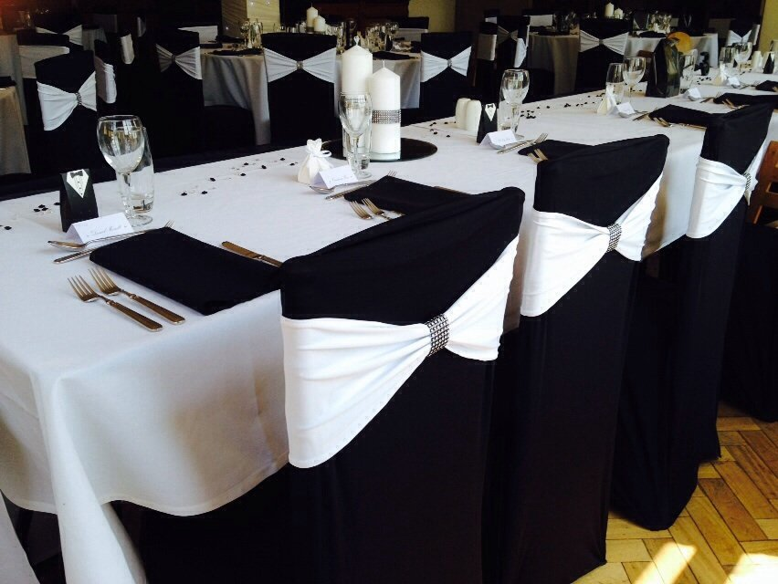 White lycra bands with bling wraps and black lyrca chair covers at Cromwell Manor