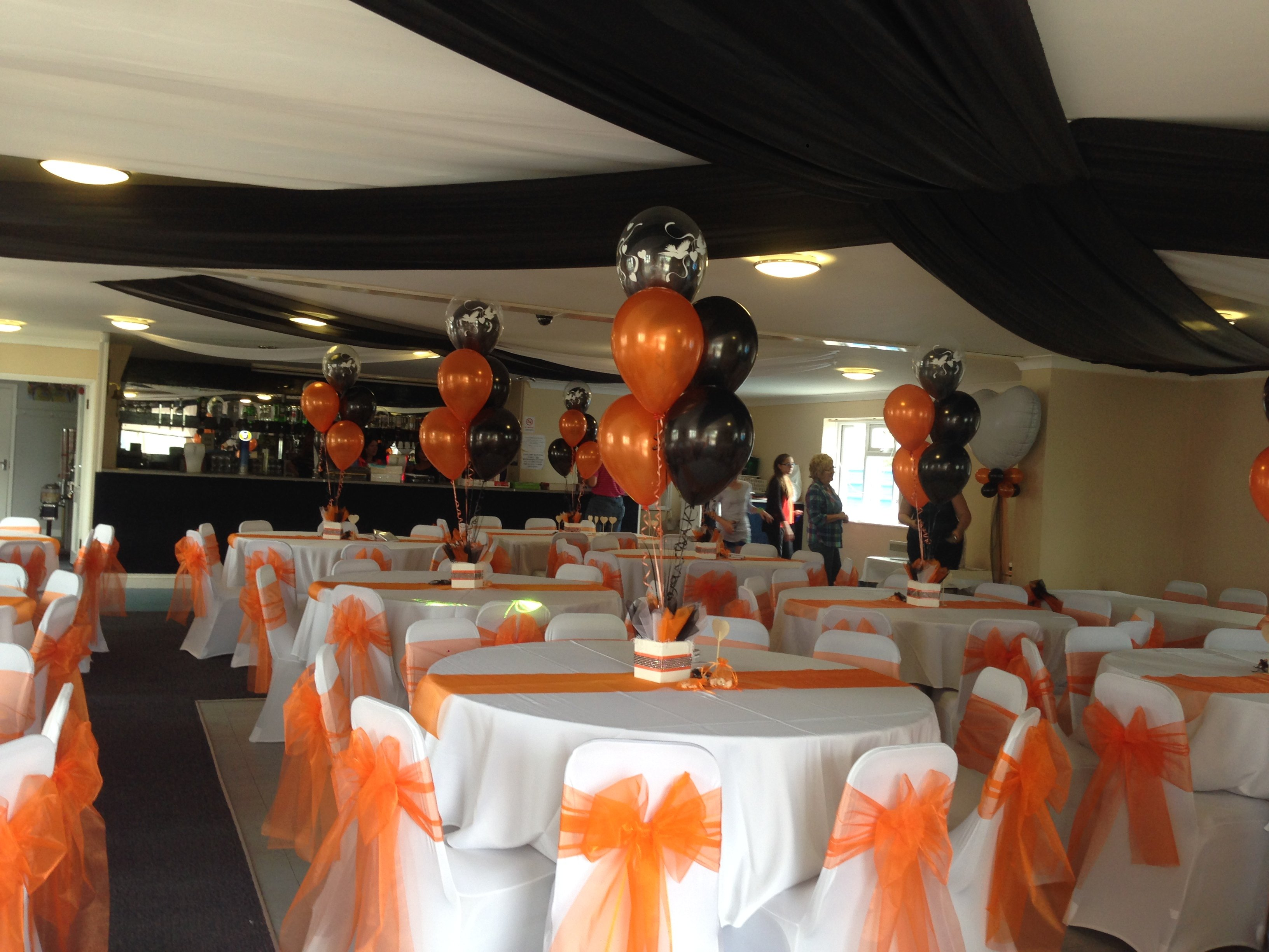 Orange organza sashes and white chair covers and Concord Rangers FC