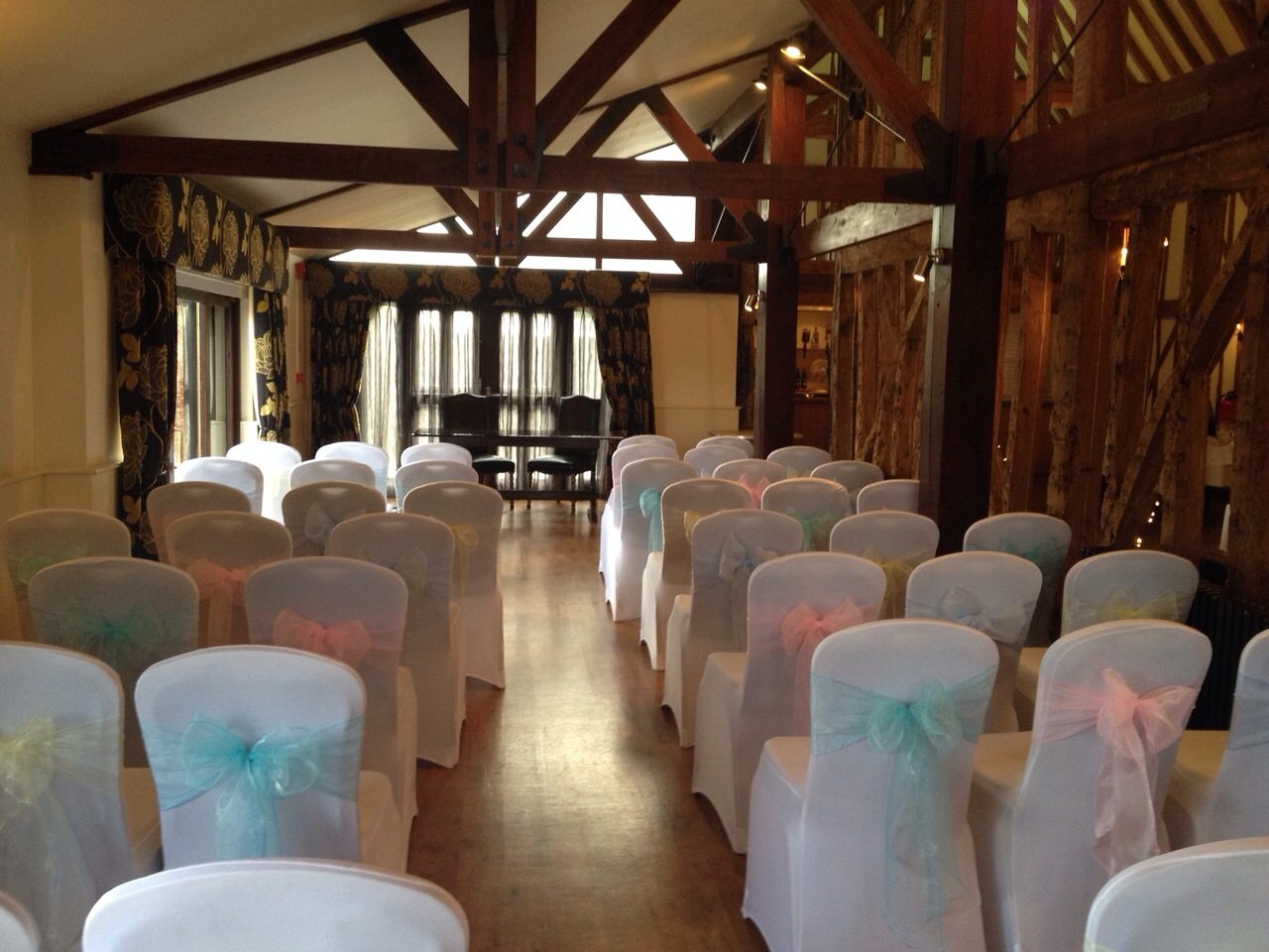 Pastel colour organza sashes with white lycra chair covers at Channels