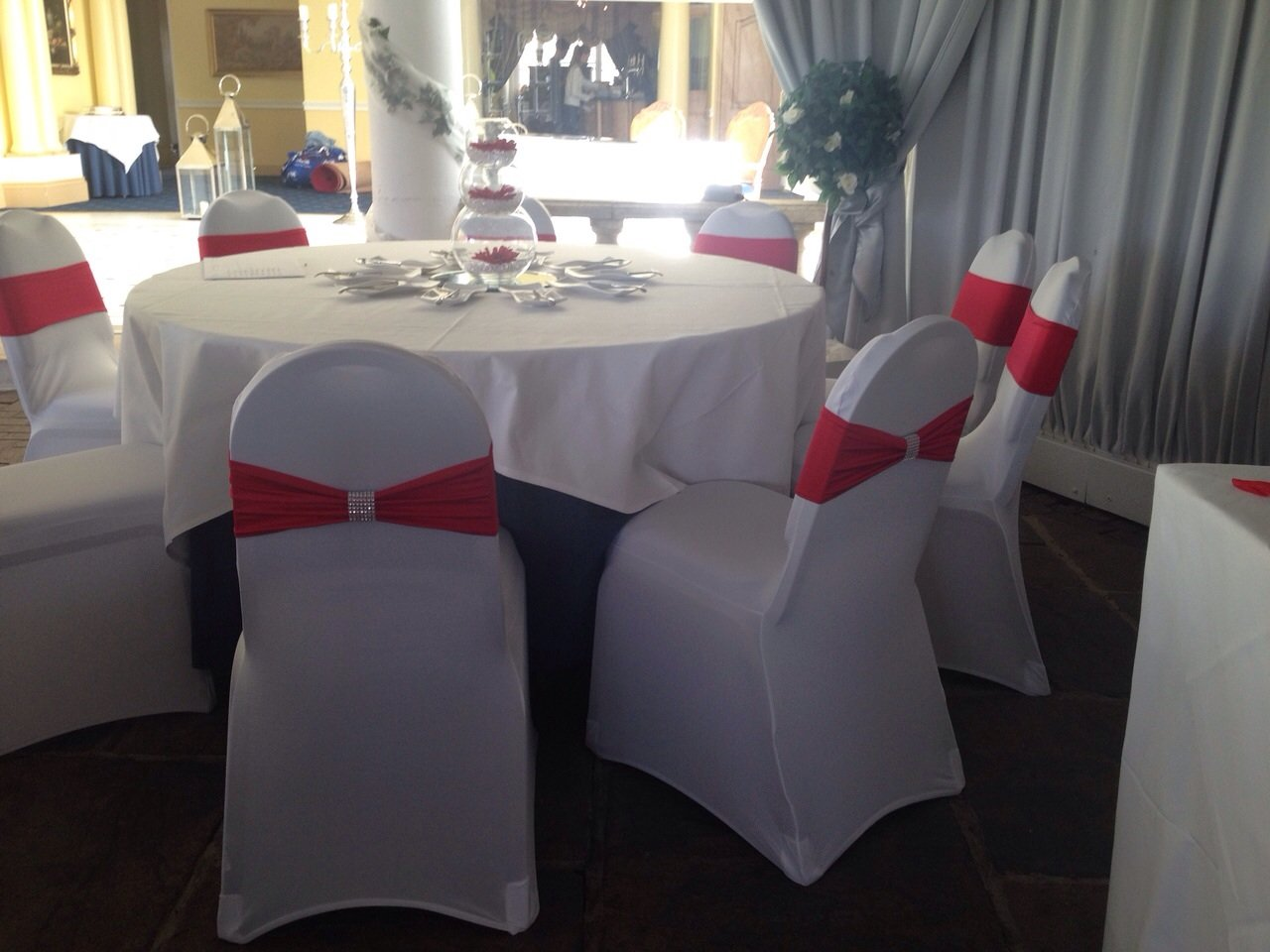 Red lycra band with bling wrap and white lycra chair covers at Friern Manor