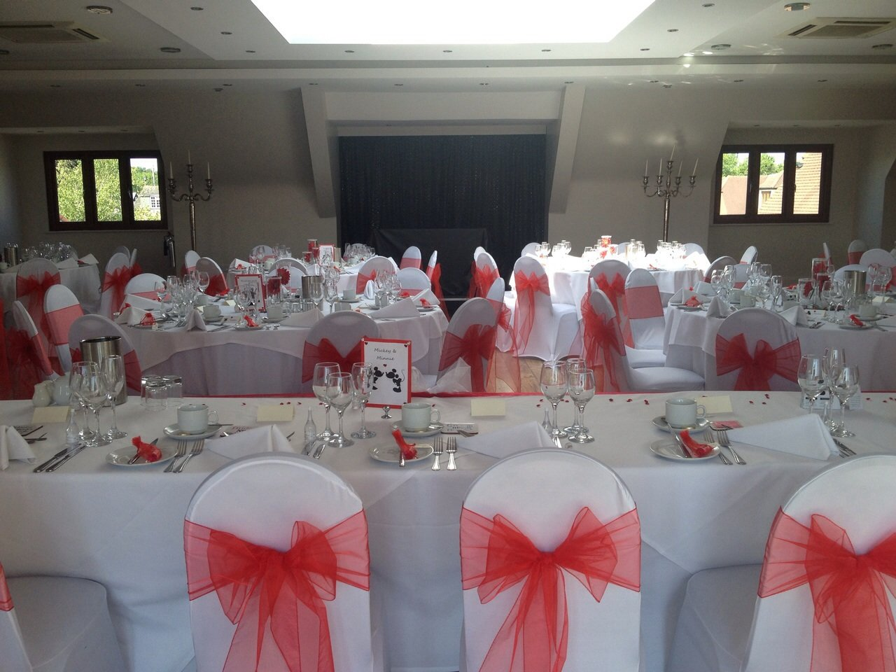 Red organza sashes and white lycra chair covers at The Rayleigh Club
