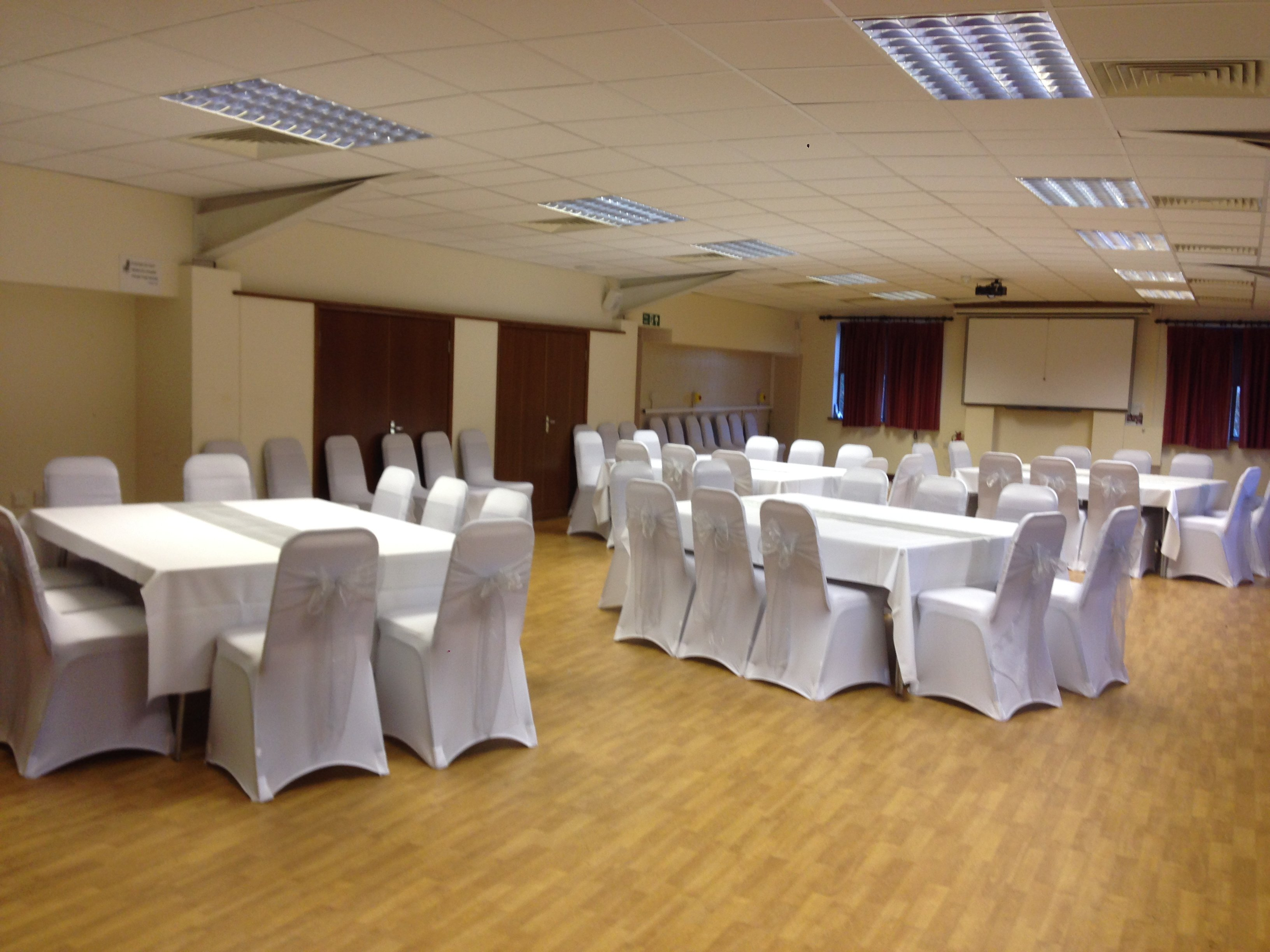 Silver organza sashes and white lycra chair covers at Barleylands function room